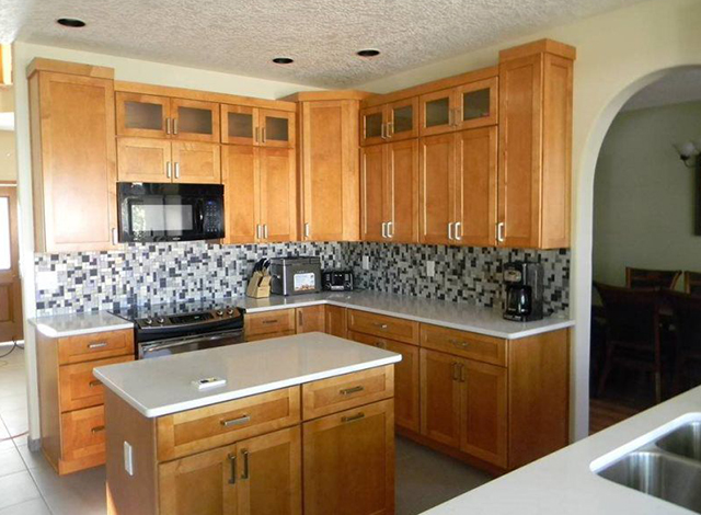large kitchen with wooden cabinets and an island